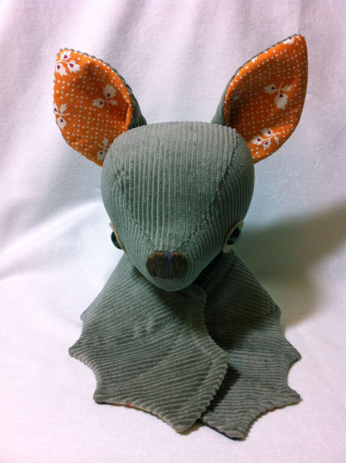 spooky-dog-ruins-everything:  Grey Halloween Batty on Etsy Super sad I can't afford him- 28usd + shipping for something both handmade AND adorable is a steal. Someone go give him a good home!