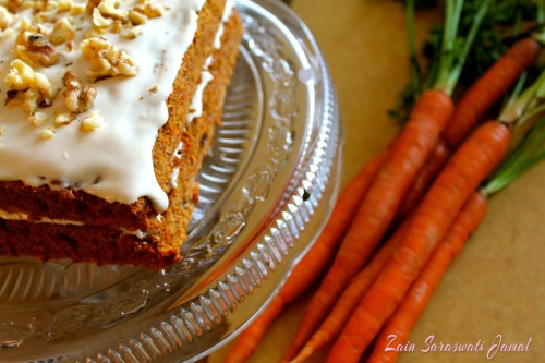 Zain's Clean & Classic Carrot Cake (Regular OR Vegan) Guilt-free carrot cake?  Absolutely!   Carrot cake has always been one of those misleading desserts that sounds healthier than it really is. Vegetables in cake - how bad could it be? Wrong. Many versions are ladden with oil and sugar. Carrot cake is a favorite dessert to fitness inspirations like Rita Catolino and Tosca Reno, and with all it's decadence it's little wonder why. However, I revamped this perfect harvest recipe to make it clean, healthy, and jam-packed with nutrients like: Vitamin A from the carrots Minerals such as iron rich raisins Beta-carotene carotenoids Fat burning cinnamon  Macronutrients For vegan modifications, click here  (see recipe substitutions in orange). Ingredients: Cake 11/2 Cups Brown Rice Flour OR Gluten Free Flour of your choice (Bob's Red Mill works great here too) 1/2 Cup Coconut Flour 2 Organic Cage Free Eggs 4 Organic Cage Free Egg whites or 1/3 cup egg white liquid 40-50 Drops Vanilla Creme Liquid Stevia 2 Tsp Natural Vanilla Extract 2 Tbsp Coconut Butter OR Coconut Oil (I use Coconut Butter) 3/4 Cup Unsweetened Applesauce 1/4 Cup Organic Carrot Baby Food OR Carrot Puree 2 Tsp Baking Soda 2 Tsp Gluten-Free Baking Powder Pinch Himalayan Crystal Salt 2 Tsp Cinnamon 1/4 Tsp Fresh OR Powdered Nutmeg (I use fresh) 1/4 Tsp All Spice 1 Tsp Fresh Ginger (minced) 3 Cups Organic Carrots (shredded) 2 Tbsp Maple Syrup (optional) 1/2 Cup Rasins Canola Spray OR Coconut Oil to grease pans Frosting 5 oz Fat Free Cream Cheese   3/4 Cup Fat Free Greek Yogurt  2 Tbsp Sunwarrior Protein Powder OR Protein Powder of Your Choice (optional)  20-30 Drops Vanilla Creme Liquid Stevia (or to taste)  1 Tsp Natural Vanilla   1 Vanilla Pod (ground, optional)  1/4 Cup Walnuts to Top (I normally soak mine overnight and allow to dry)  Directions:    1. Preheat oven to 350 degrees.  2. Grease 2 8X8 inch square pans with coconut oil or canola spray.  3. In a large bowl beat eggs, oil, applesauce, carrot puree, carrots, raisins, stevia, vanilla and maple syrup until combined.  4. In a separate bowl, mix flour, baking soda, baking powder, salt, cinnamon, and spices.  5. Slowly add the dry mixture to the wet and blend with mixer until combined. Pour into pans.  6. Bake for 40 to 50 minutes, or until toothpick comes out clean. Once cooked, allow to cool for at least 1 hour on a cooling rack.  7. Meanwhile prepare frosting by combining cream cheese, Greek Yogurt, protein powder, stevia, vanilla and vanilla pod using a food processor or hand mixer. Store in refrigerator until cake cools.  8. Once cooled, frost first layer of cake then stack second layer and frost the top.  Top with walnuts.