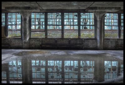 Reflecting on the Past by RiddimRyder on Flickr.Tramite Flickr: Abandoned factory with lock-jaw security.  On the Trains, Pit Bulls & Pepperoni Pizza tour.Like my photos on Facebook