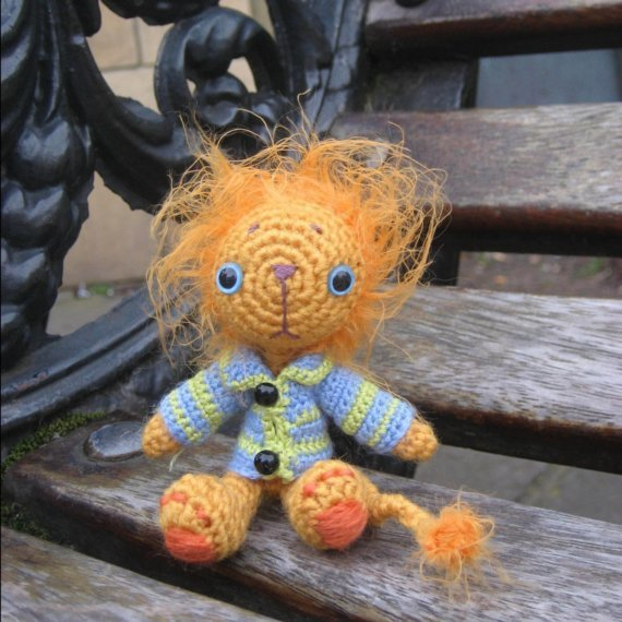 "Geoffrey the Lion (described as ""… a very hairy lion in a stripy cardigan."") Another awesome pattern from irenestrange's Etsy store."