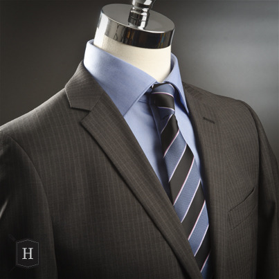Suit/Complet: $450 by Abito Shirt/Chemise $99 by Polifroni Blu Tie/Cravate: $50 by IZAC4MEN