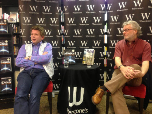 Earlier this week I went to my local Waterstones here in Edinburgh to see two science fiction authors, Iain M. Banks and Peter F. Hamilton. (The photo of the authors comes from someone on Twitter. Note how Iain M. Banks managed to sit next to the display of Hamilton's books and vice versa; they obviously weren't paying attention when they sat down!) It was an interesting Q&A session where both authors discussed their new books and various SF issues in general. I was also able to pick up and get signed a copy of the newest Culture novel, The Hydrogen Sonata, which has just been released and which I have already started (it is one I've been looking forward to reading for awhile). I confess that Banks was the main attraction for me as I actually haven't read any of Hamilton's books, but after seeing him talk I believe I will soon rectify that, and I'll likely pick up either his newest book or one of his older ones soon - I'll be getting it on the Kindle though, his books are notoriously massive, something which he was asked about last night. Overall, it was an enjoyable evening, Banks is always an entertaining speaker (and I should know, given how I'm practically stalking him by seeing him every time he appears near where I'm living!) and Hamilton was also interesting and certainly I'm now more inclined to check out his writing (although he has been on my radar for awhile, this has just given me the kick I need). I had a good time and I will hopefully be going to see any other SF and Fantasy authors that appear in the future, as I do enjoy these types of events.