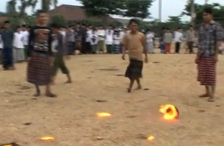 """Fire football popular in East Java boarding schools"" The beautiful game is on fire in Indonesia - literally. A 'ball' that is actually a flaming coconut, is used in a friendly kick-about amongst students in Indonesia.  The coconut is soaked in kerosene for two days before it is lit. The kick-about lasts for about 60 minutes and between four to six coconuts are used in total during the match. ____________________ Wasn't there an episode of Friends about Joey and Chandler doing something kind of like this? And, yes, setting stuff on fire is more fun. #UntilYourAssGetsBurnt"