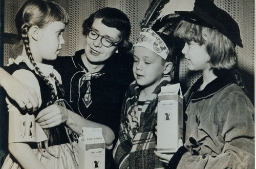 the-seed-of-europe:  Mary Emma Allison, the founder of the Trick-or-Treat for UNICEF (United Nations Children's Fund) with trick-or-treaters ca. 1950. The program was started on a private level by Allison after she got the idea from seeing a UNICEF booth collecting powdered milk for undernourished children around the world. On Halloween in 1950, children of the Allison family and their friends from the local community went door to door collecting funds instead of candy for the aid children whose lives were affected by WWII. They collected a total of $17 dollars, all of which was donated to UNICEF. UNICEF actively promoted the program and by 1960 it had spread throughout the US, and its trick-or-treaters became recognizable by the small orange collection boxes reminiscent of the original decorated milk cartons Allison gave to her trick-or-treaters in 1950.