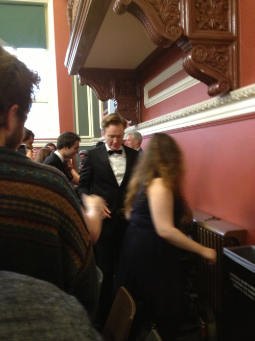 I JUST SHOOK CONAN O'BRIENS HAND. He was speaking to my university's Philosophical Society. We were in the back row. It's a smallish hall so we could see fine, BUT it was amazing because we were right in front of the door so he was about a foot behind us when he came in and waved eeeek. AND when he was leaving he shook the hand of everyone in my row!!!! And complimented my friends red hair!! (He has a nice handshake if you're wondering.)