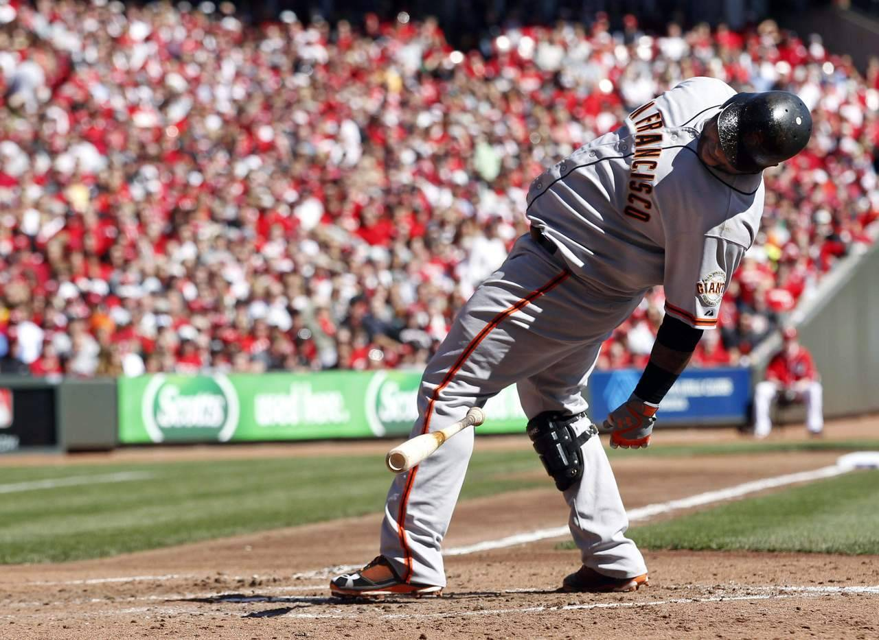 Lean back: Giants third baseman Pablo Sandoval is moves away from a pitch by Cincinnati Reds starting pitcher Mat Latos (55) in the fifth inning of Game 5. (Photo: REUTERS/Jeff Haynes)