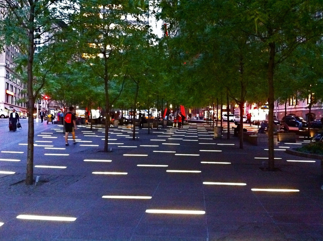 "An occupier participates in a little-known action in Zuccotti Park in the wee hours of the morning, drawing the blueprints of the #OWS encampment in chalk:  ""From this angle all I can see are his boots, more particularly the black military boot, buckled in silver that is blocking my ability to finish my chalk drawing. It is three in the morning and I am about to be arrested. I am using chalk to draw out the blueprints of where the tents had been prior to the dismantling of the Occupy Wall Street encampment by the NYPD in Zuccotti Park."""
