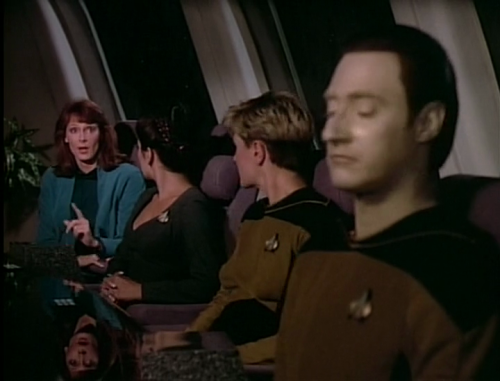 Dr. Crusher pulls out this amazing show-stopper grabbing the attention of both Deanna and Tasha! Data, however, openly shows his displeasure… he simply just doesn't care for it!