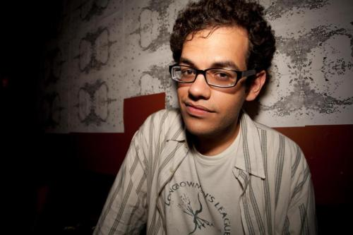 "San Francisco Comedy and Burrito Festival Countdown: Ivan Hernandez (""Powerful brown hands delicately remove the tortilla from the grill, a mound of crisp chorizo beside it. Hands which had delivered babies while firing weapons at nationalist armed groups ladle rice upon the flour surface, black beans following in a metaphor for the mixed race relations which had created his people. Avocado sliced in mathematically equal portions lay in parallels atop the mound, green as the fields of Mars before Or'lithikk the Sunderer brought forever desert to the planet. A dollop of sour cream, maintaining its thick consistency and cold despite being encased in heated meats due to a heretofore unexplained quirk of physics. Queso fresco lies across like the rubble left in an eastern European nation after civil strife. The chorizo burns almost black, the grease it emits equivalent to the blubber obtained from an infant gray whale. A spatula slides under the chunk of pig refuse and delivers it unto its cradle. A last bit of salsa completes the equation, spicy enough to register on the palate but mild enough not to upset the blandness of said palate. With movements practiced hundreds of thousands of times to maximize efficiency, hold, and consistency of bite, the burrito forms. And in less time than it takes to sew together this Frankenstein's Monster of ethnic cuisine, it is eaten."") [Today!]"