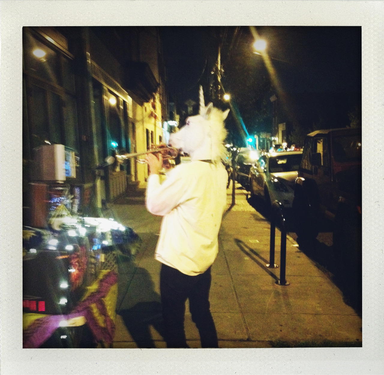 The unicorn man playing his trumpet in Fishtown.