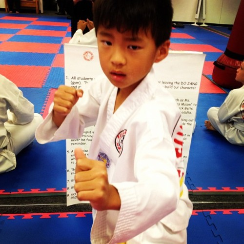 fightlikeafemale:  Tyler #tkd #martialarts #cute #kids (Taken with Instagram at Flying Kick Martial Arts & Fitness )