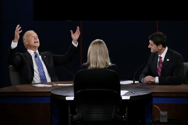 pantslessprogressive:  The VP Debate, in one photo. [Reuters/@BuzzfeedAndrew]