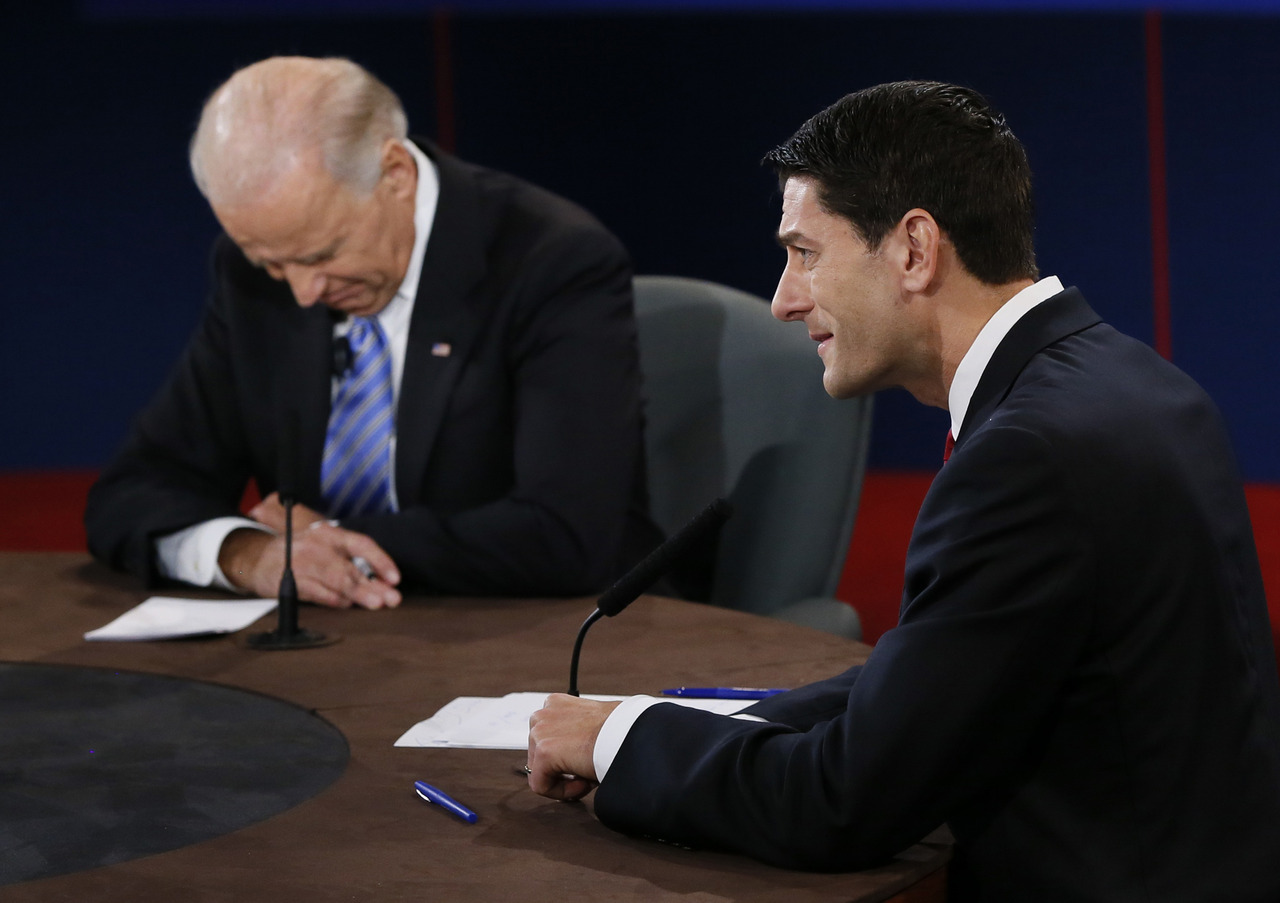 U.S. Vice President Joe Biden listens as Republican vice presidential nominee Paul Ryan speaks during the U.S. vice presidential debate in Danville, Kentucky, October 11, 2012. [REUTERS/Rick Wilking] LIVE COVERAGE: The 2012 Vice Presidential Debate