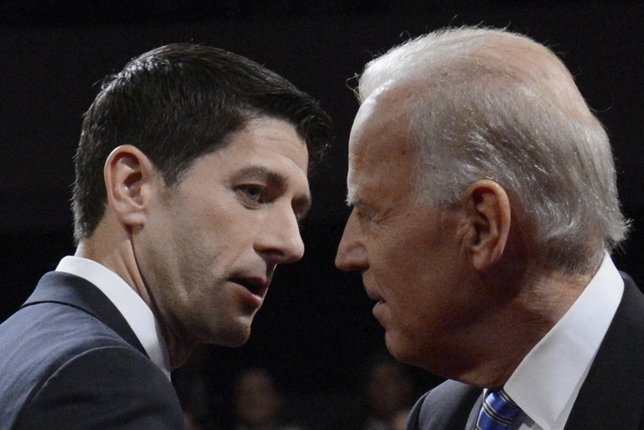 U.S. Vice President Joe Biden and Republican vice presidential nominee Paul Ryan shake hands at the conclusion of the vice presidential debate in Danville, Kentucky, October 11, 2012. [REUTERS/Michael Reynolds/POOL] RECAP: Biden comes out swinging at debate, clashes with Ryan