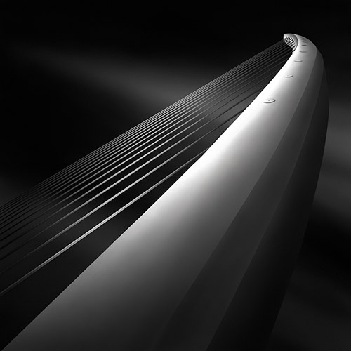"Julia Anna Gospodarou like a harp's strings III - rising - International Photography Awards IPA 2012 - Honorable Mention - _Katechaki Pedestrian bridge, Athens – Architect Santiago Calatrava_ ""I am an architect and a Fine Art photographer living and creating in Athens, Greece and my main body of photographic work consists in black and white images created using the technique of long exposure, but also exploring fields like motion blur or intentional camera movement. I love to photograph everything around me, but I have always had a special affinity for cities and architecture and nowadays this is a clear direction towards which my work is going…(more)"