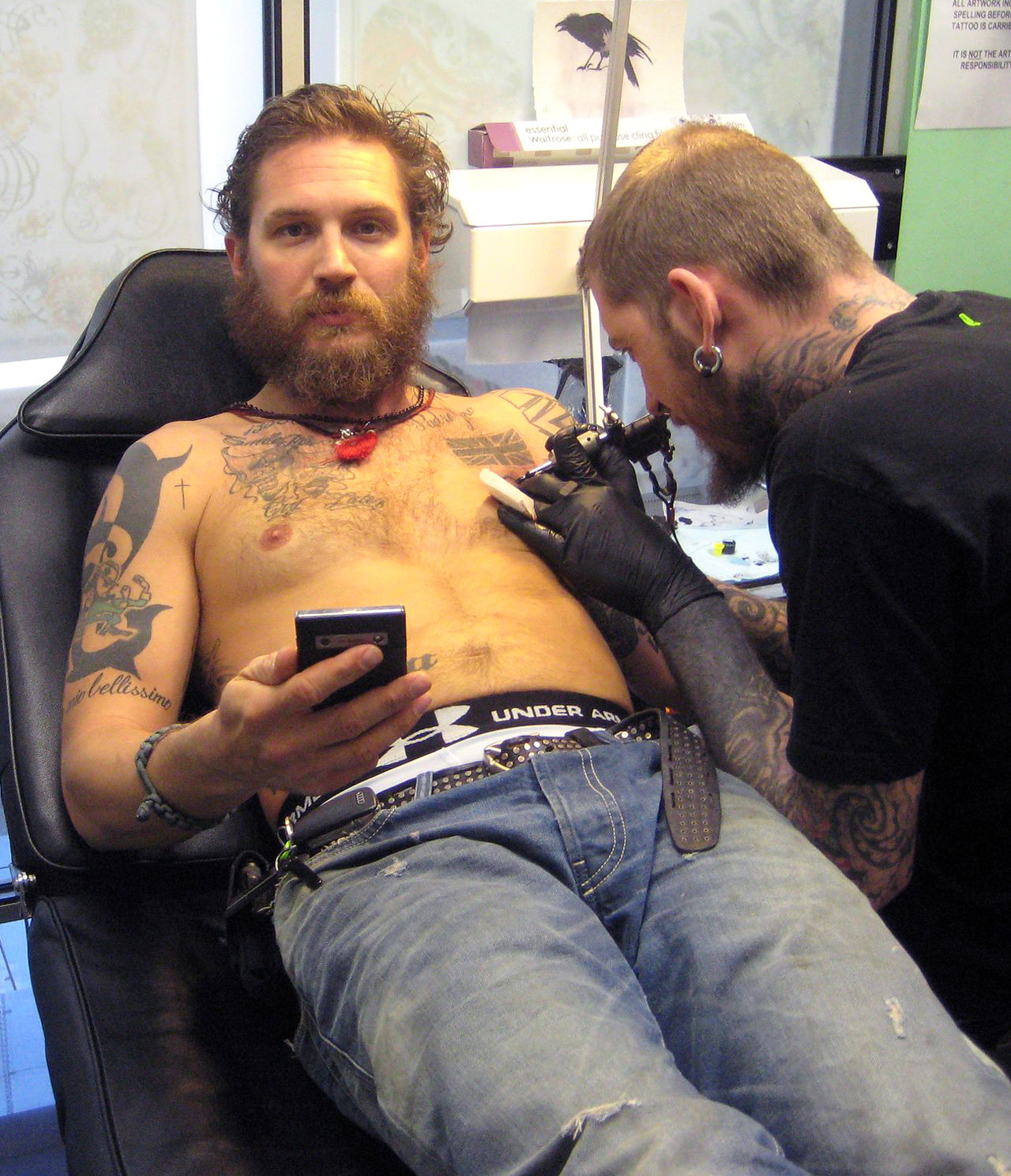 jellysoap:  tomhardyvariations:  hi. xxxxx @Richmond Tattoo studio   TAKE THEM OFF  There are secrets hidden in that beard just waiting to be discovered.