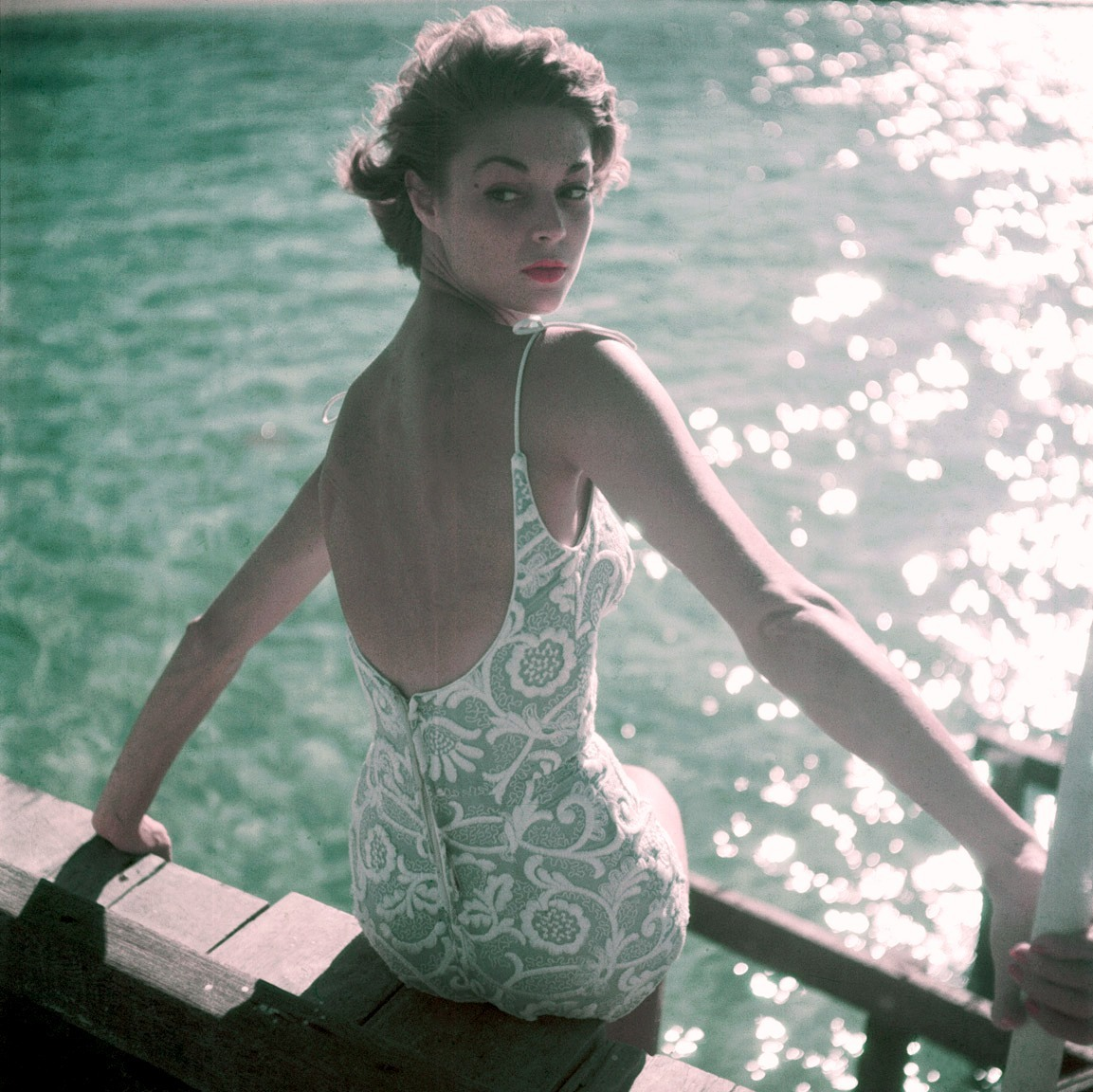 theniftyfifties:  Jean Patchett in swimwear, 1950. Photo by Clifford Coffin.