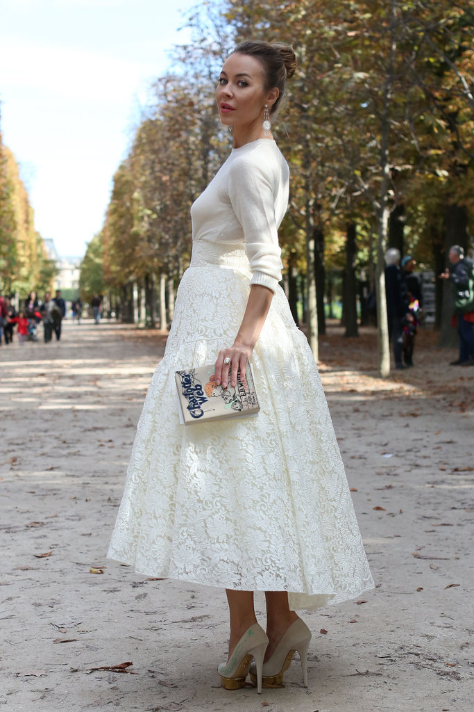 Ulyana Sergeenko wearing the Charlotte Olympia x Olympia Le-Tan Charlotte's Web shoes and book-clutch during Paris fashion week.
