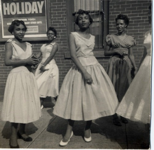 Girls posing in pretty dresses, 1950s.