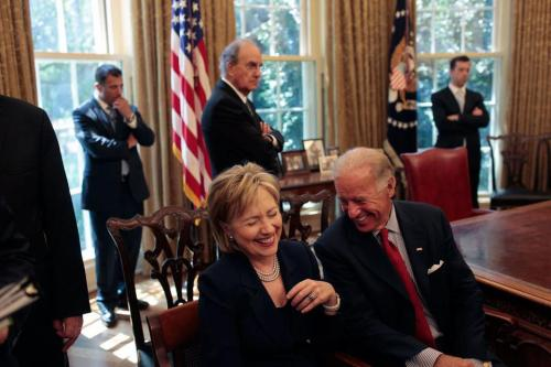 "Secretary Clinton listens to Vice President Biden recount last night's vice presidential debate.Biden: ""And then I said, 'Oh, now you're Jack Kennedy?' Did you see his face?"" Original photograph source unknown."