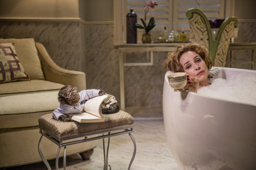 "Good morning. Here's Annie Potts in a bathtub while Crystal the Monkey reads a book nearby in a scene from ""Animal Practice"" on NBC. Happy Friday."