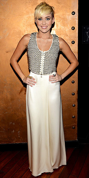 Miley Cyrus in cream colored wide-leg trousers and zipper vest by Temperley London … Stunning!