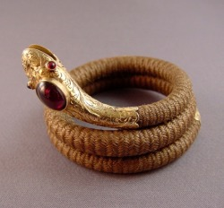 highvictoriana:  Victorian snake coil bracelet, 14K gold, garnets and a woven real hair band, c. 1880
