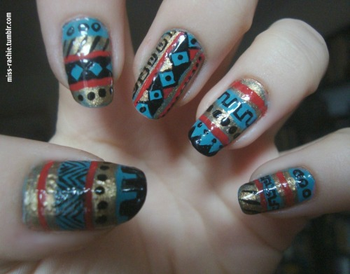 Tribal/Azteck nails :D Colors used: Essence, multi dimension: Tryin' to be cool Eveline: Color show (498) Some random gold polish Nail Paint by BarryM: Black