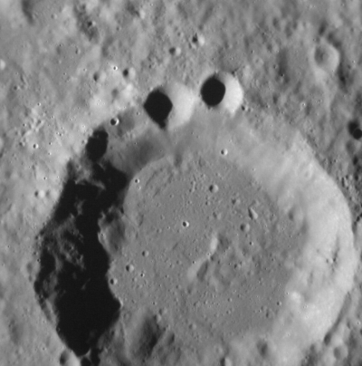 sesamestreet:  NASA asks if anyone else thinks that the crater pictured above, on Mercury, looks like Cookie Monster.  We think so. Now that we think about it, maybe Mercury is Cookie Monster, or his distant cousin maybe (?), and it's circling the Sun in hopes of om nom noming some space cookies or something. Okay, maybe not.  Anyway NASA, thanks for thinking of us.