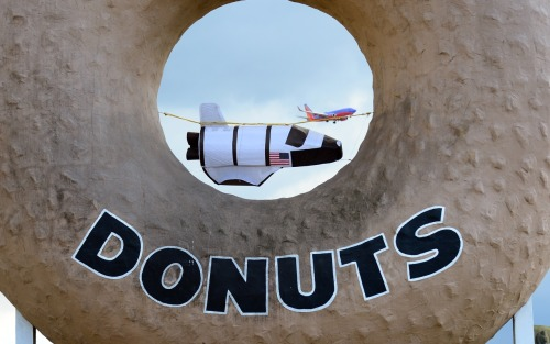 The space shuttle Endeavour will go right past Randy's Donuts in Inglewood as it makes its way to its permanent home at the California Space Center. Meantime, there's a model shuttle holding its spot.  More photos of Endeavour's journey: http://usat.ly/RlQuRv(Photo by Frederic J. Brown, AFP/Getty Images)