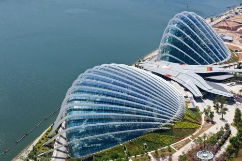 Cooled Conservatories by Wilkinson Eyre Architects Recently winning World Building of the Year at the World Architecture Festival the Cooled Conservatories at the Gardens by the Bay in Singapore are a magnificent tropical gardens full of plants from across the globe.  Artists: | Website | [via: The Fox Is Black]  Watch: