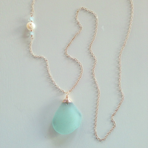 "Gorgeous large piece (1.5""x1.25"") of ocean blue Maui sea glass wrapped in 14K gold filled wire and dangling from 30"" 14K gold filled chain.  Puka shell and Swarovski crystal accents.  The longest part of the necklace hangs at the bottom of your bust, depending on your bust size. www.shellchicmaui.com"