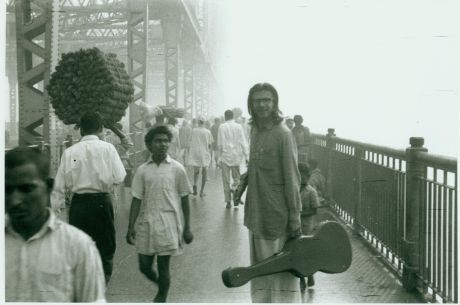 Peter Orlovsky on the Howrah Bridge that spans the Hooghly River (Ganges), Calcutta, Summer 1962. c. Allen Ginsberg Estate.