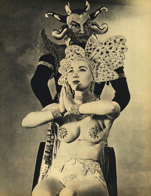"burleskateer:   Gene Gemay (and her Genie) appears in a pictorial scanned from the July '53 issue of 'GALA' magazine.. Her strip routine was themed around the ""Arabian Nights"" mythology.. Dancing in a harem outfit & rubbing a large Aladdin's Lamp onstage,—  a rubber mannequin ""Genie"" would magically arise!"