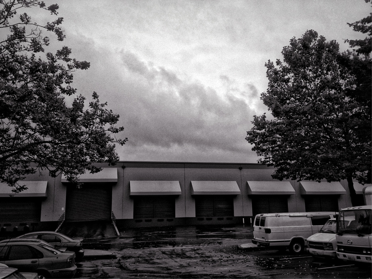 Storm Clouds Over The Warehouse #dramaticbw © 2012 Kent Kangley