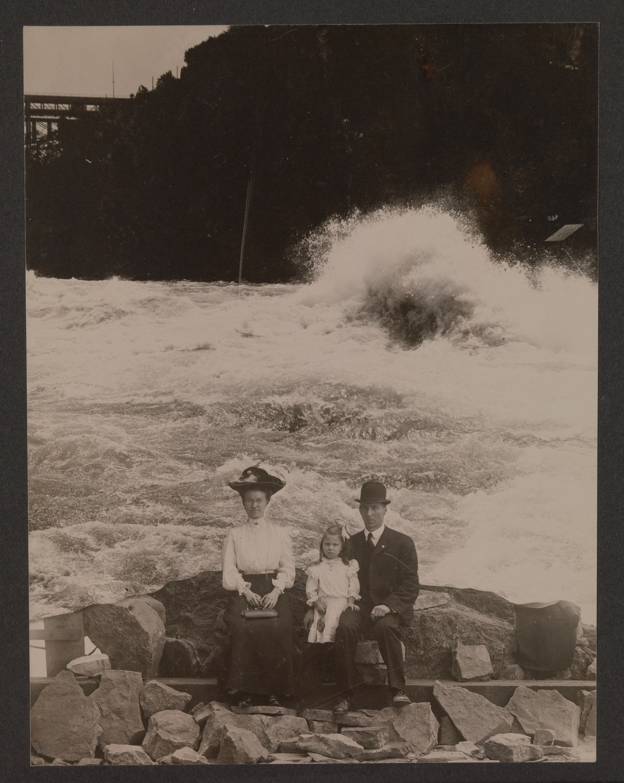 "1905 ""Around the turn of the twentieth century, visitors to Niagara Falls could have portraits of themselves inserted into a variety of stock backgrounds depicting the falls from vantage points that were inaccessible to tourists."""