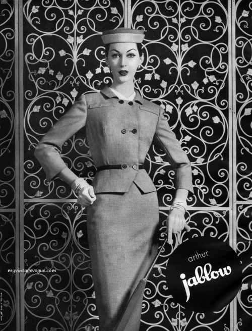 Dovima wearing a suit by Arthur Jablow 1956