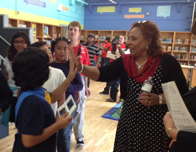 "lausdpress:   An emotional Library Makeover at Western Avenue Elementary School as Principal Bettye Johnson thanked Target and The Heart of America Foundation for new technology, including iPads, and 2000 new books!  Choking back tears, Principal Johnson said that before today there was not a book in the library added after the year 2000.  The books and the technology were old at the 102 year old school, but now everything is new again!  Principal Johnson, her staff, the students, and their families couldn't be more grateful.  ""These students are our future,"" said Johnson.  ""If we don't give them books, what can we expect from them?"" Principal Johnson was joined by Board Member Marguerite LaMotte, Executive Director of the Office of Curriculum Gerardo Loera, and other LAUSD staff and community members for this ribbon cutting and celebration of the new space. In 2011, Target contributed more than five million dollars to support the Los Angeles community by funding programs like Target School Library Makeovers, Target Field Trip Grants and Take Charge of Education.  The Los Angeles Unified School District is extremely grateful to Target and The Heart of America for all their efforts to promote the learning and health of our students. CLICK HERE for more information about Target's commitment to corporate responsibility.  CLICK HERE to learn about The Heart of America Foundation, a national nonprofit promoting volunteer service and literacy."