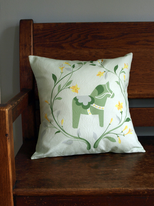 And close up, the new green dala horse pillow.