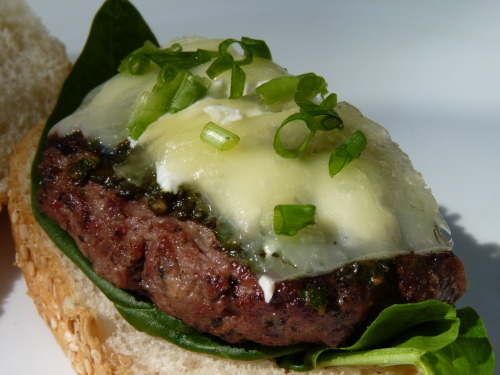 Get in my stomach. Hamburger with manchego cheese. Local ingredients: spinach, pesto, green onions, and goat cheese.