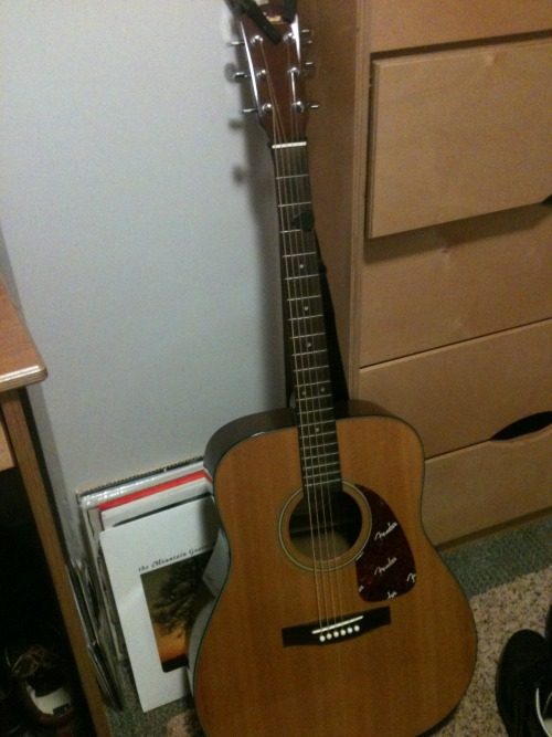 "I bought a guitar the other day because I couldn't stand it anymore.Since it's a used instrument it only cost $65 at Guitar Center, so I got myself a $20 strap. It isn't anything amazing and it certainly isn't my Washburn, but it will certainly do for now. I'm not sure what his name is yet… I know it's a ""he,"" but it's difficult because he's used. I feel like he's a gentleman, but doesn't take shit. Modest and has his priorities straight. ""Thomas"" sounds about right. Any suggestions?"