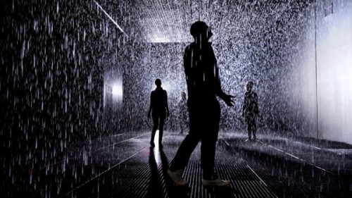 """Devised by UK-based rAndom International, the ""Rain Room"" allows visitors to pass through a downpour without getting wet. The installation is set on a darkened stage solely lit by one large spotlight. Cameras map human movement in the 100-square-meter room and send instructions for the rain to move near people, yet not too near, as they traverse the space."" Really wish I could try this."