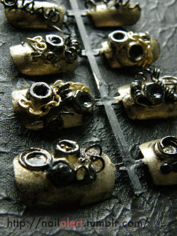 Listed these on etsy: Link They are made of nuts, screws, metal wire, polish, and rhinestones and whatnot. Also pretty heavy.