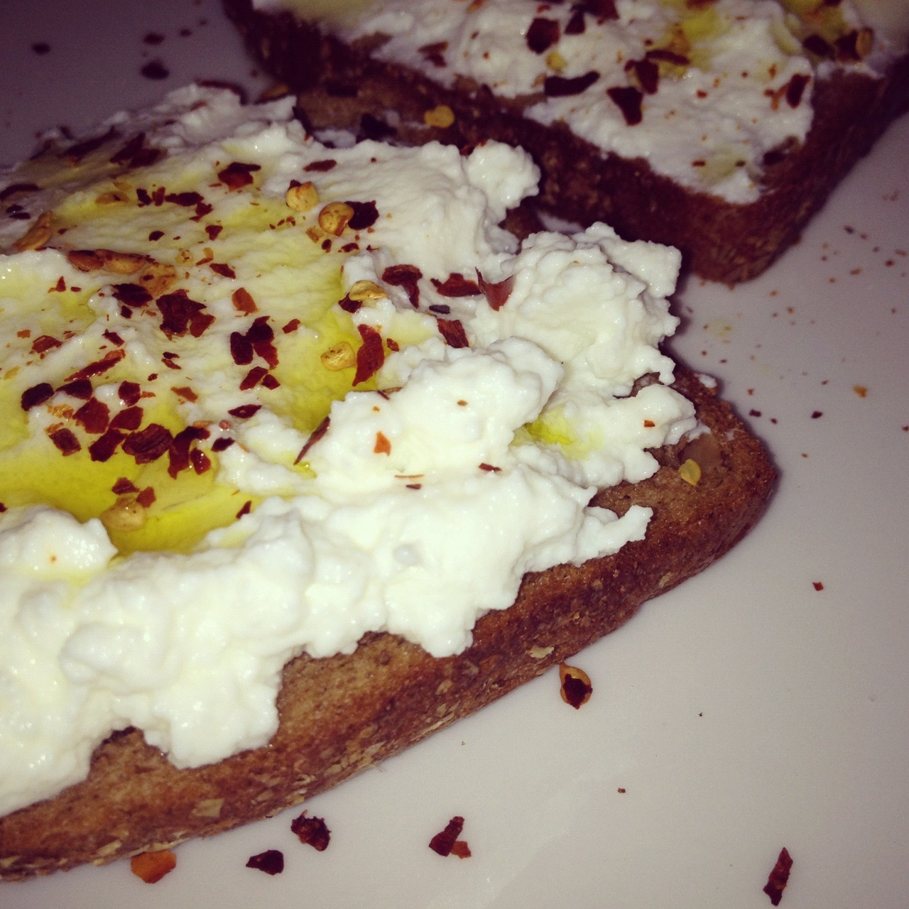 Ricotta, olive oil, sea salt and chili flakes on rye.