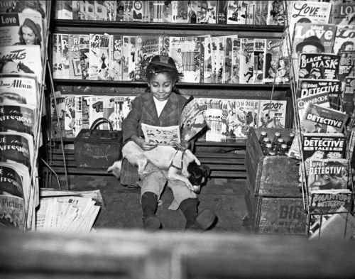 "COMIC GIRL | 1950s Young African American girl reading comic book in newsstand. Charles ""Teenie"" Harris (1908-1988), photographer. Teenie Harris Archive, Carnegie Museum of Art, Pittsburgh, PA FIND US ON TWITTER 