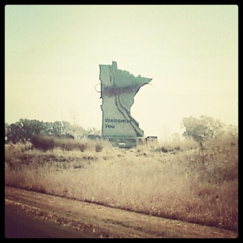 "edkohler:  wr3n:  Yay (Taken with Instagram at Minnesota State Line)  Has the ""Minnesota"" portion of this sign been touched up by an elderly Spanish fresco restoration artist?  Ecce Minnesota."