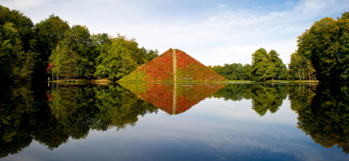 "The ""Seepyramide"" (Lake Pyramid) reflects in a lake, Sept. 25, 2012 at the Fuerst-Pueckler-Park in Branitz near Cottbus, eastern Germany. Count Hermann Ludwig Heinrich von Pueckler-Muskau, a German nobleman who is known for his passion for landscape gardening, is buried in the interior of the pyramid. © Patrick Pleul/AFP/Getty Images"