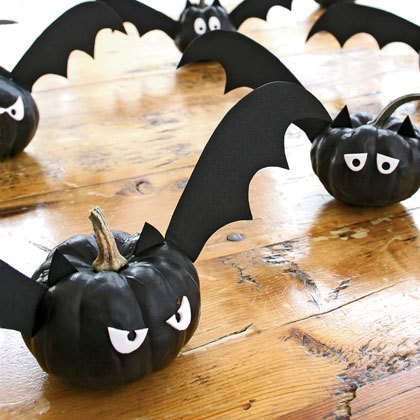 allhalllowseve:  Bat-o'-Lanterns Materials Black acrylic paint Ornamental (miniature) pumpkins Black and white craft foam Wings,ears & eyes template Hole punch Glue dots Black duct tape Toothpicks Wooden skewers Cover your work surface with a drop cloth or newspaper, then paint the pumpkins. Allow them to dry completely. For each bat, choose a style of wings and eyes from the template.Then, trace and cut out two identical eyes from the white craft foam and use the hole punch to make pupils. Adhere the eyes to the pumpkin with glue dots. Cut a matching pairs of ears and wings from the black craft foam (our wings are about 6 inches long). Attach the ears by taping a toothpick to the back of each one, leaving about 1 1/2 inches of the toothpick exposed, then inserting it into the top of the pumpkin. Finally, tape a skewer to the back of each wing, leaving a 2-inch point exposed, and push it in place.