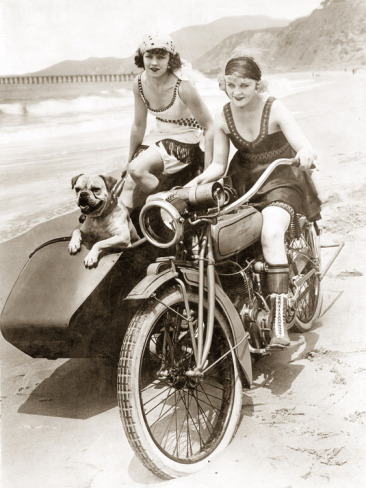 Girls and a motorcycle with a sidecar from the 1920's.