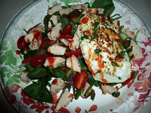 Spicy Chicken Salad Today's brunch was grilled chicken, red and green bell peppers, spinach, cilantro, tomatoes, onion, mushroom, fried egg, and hot sauce. All organic, all the time. So good!
